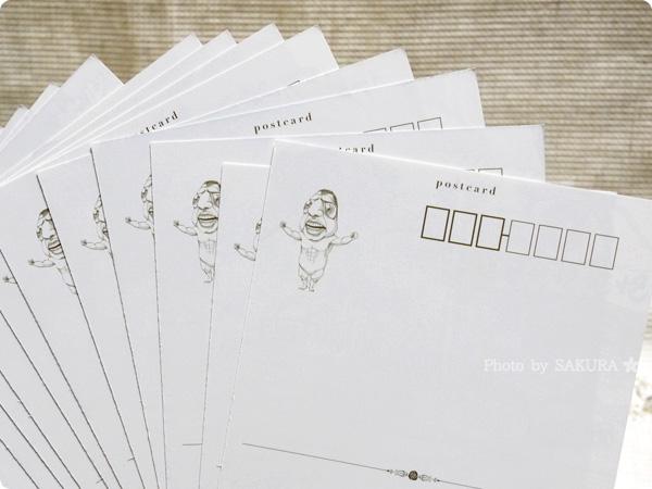 『ポストカード52枚&クリアアルバム付き』 ポストカード52枚の裏側にミニ巨人
